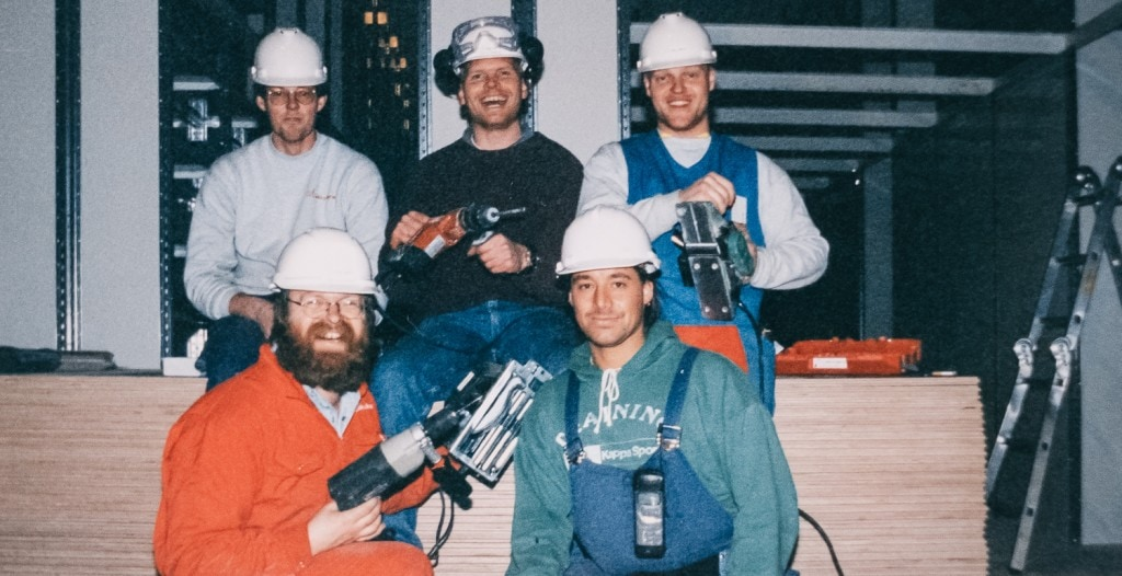 Old photo of Element Logic employees with power tools