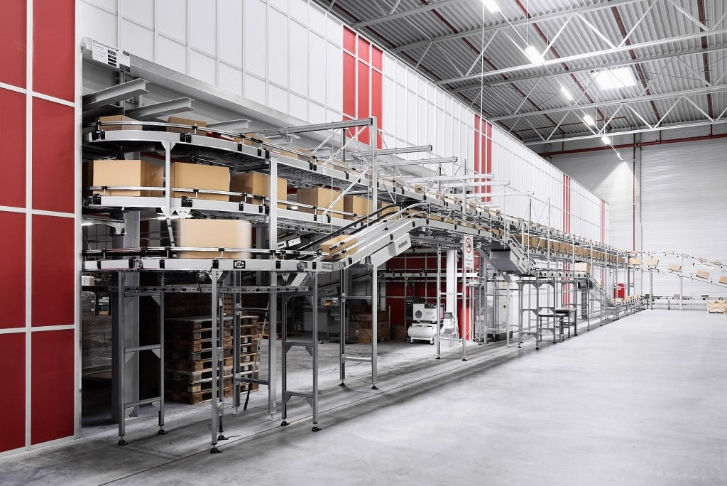 conveyor technology in AutoStore warehouse